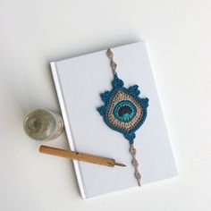This is a crocheted peacock feather bookmark that fits a 21 cm / 8.4 inch book. It is my original design, made in my own curio crafts room. It