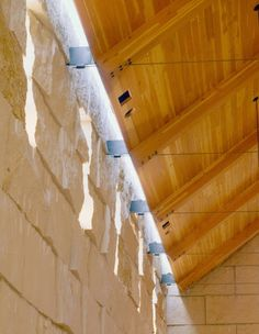Closer look at interior roof attachment of Cistercian Abbey Church in Irving, TX.  Glass block is used as a continuous skylight running the length of the walls to bring in natural light.