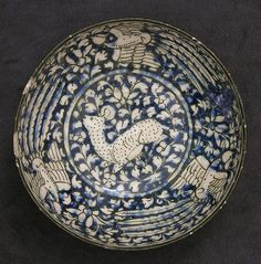 Bowl with Deer and Phoenix Motifs Object Name: Bowl Date: first half 14th century Geography: Iran, probably Kashan Culture: Islamic Medium: Stonepaste; blue and black painted under transparent glaze (Sultanabad ware) Dimensions: Diam. 6 5/8 in. (16.8 cm) H. 2 3/4 in. (7 cm) Classification: Ceramics