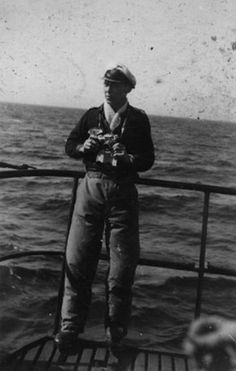 The skipper of U-960, Oberleutnant zur See Günther Heinrich (1920-) , posing on the U-boat with a camera.  U-960 was sunk on 19 May 1944 in the Mediterranean NW of Algiers, by depth charges from USS Niblack, USS Ludlow plus Wellington and Ventura aircraft. There were 31 dead and 20 survivors.