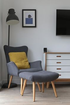 Use bold and bright soft furnishings and wall art to transform a room with a grey colour scheme. The grey armchair, matching footstool (Homesense) and the grey Hektar Ikea lamp are 'brought to life' with the colourful Beth Jordan Cushion, Jacky Al-Samar Home Living, Living Room Decor, Kitchen Living, Dining Room, Modern Living, Ikea Floor Lamp, Ikea Lamp, Hektar Ikea, Living Room Color Schemes
