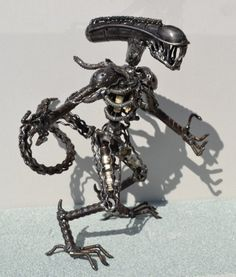 Hand Made ALIEN 12 Inches  Recycled Scrap Metal Art. $95.00 USD, via Etsy.