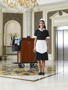 View top-quality stock photos of Maid Standing By Cleaning Trolley In Hotel Foyer Smiling Portrait. Find premium, high-resolution stock photography at Getty Images. Maid Outfit, Maid Dress, Hotel Foyer, Forced Haircut, Cleaning Maid, French Maid Costume, Staff Uniforms, Mold In Bathroom, Maid Uniform
