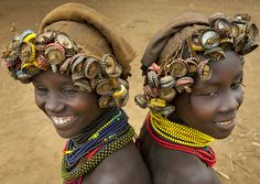 The Daasanach people of Ethiopia collect the caps of the Coca and beers in the bars of Omorate and make wigs with them.