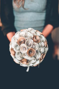 This bouquet is made from book pages turned into paper roses. By Bookswell. | via 40 Alternative Wedding Bouquet Ideas http://emmalinebride.com/planning/alternative-bouquet-ideas/