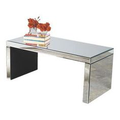 Mirrored glass coffee table. Product: Coffee table    Construction Material: Wood and  mirrored glass    Color: Silver   Features:  Bold silhouette wrapped in mirrored paneling    Brings a glamorous touch of style to your home dcor   Dimensions 17 H x 39.5 W x 18 D