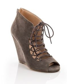 These beige lace up ankle boots are so cute.  Open toe.