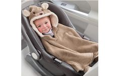 "Happy! @MomTrends loves our #CarSeat Coat keeps #baby ""snuggly & warm... allowing safe use of the car seat harness."""