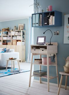 A corner in the livingroom with a standing desk where you can read your e-mails, pay your bills and keep your keys.