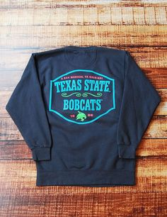 Stay trendy while showing your school spirit in this for Custom t shirts san marcos tx