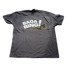inspired by the sopranos t shirt bada bing - If you love the Sopranos, you will love this Brilliant T-Shirt from the famous strip club in this Awesome series.It comes in a Dark Grey colour, has the wording 'Bada Bing' in White and features a Black silhouette of a woman.This Movie T-Shirt is inspired by the TV series Sopranos.