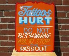 I believe this sign should be posted on the door of every tattoo shop to keep the wusses away . . .  =)