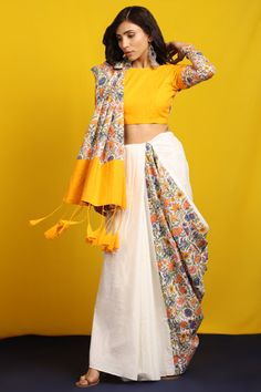White and Multi color block printed mulmul cotton saree. Comes with tasseled pallu and saffron unstitched blouse peice. Cotton Saree Blouse Designs, Half Saree Designs, Fancy Blouse Designs, Saree Wearing Styles, Saree Styles, Moda Indiana, Block Print Saree, Modern Saree, Saree Trends