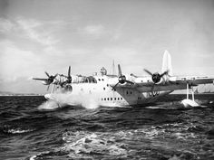 """British Sunderland flying boat that served throughout the war in a naval recon role makes a landing on choppy seas. Slow but sturdy and sound, the """"Tired Bee"""", as she was called by German sub crews due to the characteristic drone of her engines, became early on the worst enemy of submarines. She could fly slow, which allowed for accurate observation, and carried enough weapons to make an impression."""