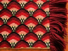 Gorgeous bargello needlepoint in excellent condition. Can be used to make a large pillow or to cover a piano bench. Or use as table runner. Size approx. 21 x 35 inches (excludes fringe).