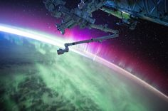 August 15, 2015: Aurora coating the planet in glowing pink and green. Image credit: NASA/Scott Kelly