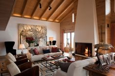 Swiss Chalet with interior designed by Tino Zervudachi in Gstaad, Switzerland. Chalet Interior, Interior Design, Living Room Decor, Living Spaces, Living Rooms, Upholstered Walls, Chalet Design, Swiss Chalet, Comfortable Sofa