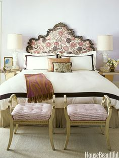 Romantic bedroom with an antique headboard. Design: Jay Jeffers.