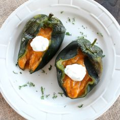 Roasted poblano peppers are filled with creamy butternut squash for a rich, flavorful, vegan and gluten free side dish!