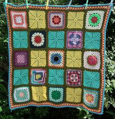 Ravelry: theemuts' Song of Summer, starburst granny squares and flower granny squares blanket.
