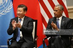 US President Barack Obama and Chinese President Xi Jinping clap as UN Secretary General Ban Kimoon delivers his speech during a joint ratification of...