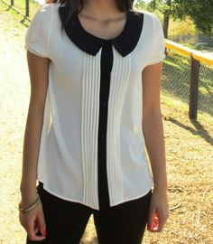 I love the collar and black and white look and the pleats