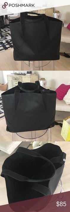 Lululemon leather bag Lululemon leather bag. Includes shoe bag and mini tote. Wearing at corners lululemon athletica Bags