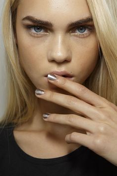 Alexis Mabille was inspired by boxing for her Spring collection, but this metallic gunmetal manicure is something you'd never see in the ring. #PFW