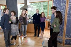 This Picture portrays the American Dream involved with the Cullen Family. If the reader didn't know the Cullens were vampires they could automatically conclude that they have perfect lives. The Cullens are Beautiful, smart, rich, they live in a huge house, the own the newest and greatest cars. Everyone that goes to Forks High School envy the Cullens. Everyone Loves to read about a great success story and always favors the character that achieves the American dream.
