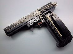 Functional LEGO Pistol (with GIF) : 4 Steps (with Pictures) - Instructables Cool Nerf Guns, Lego Guns, Star Wars Guns, Lego Boards, Lego Club, Amazing Lego Creations, Best Gaming Wallpapers, Lego Craft, Lego Military