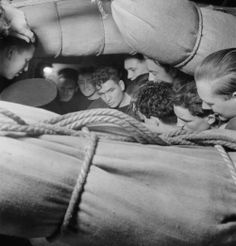 Cramped conditions on the mess deck aboard the armed merchant cruiser HMS Alcantara on voyage to Sierra Leone, 1942