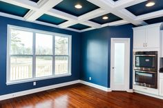 Coffered ceiling pictures, for people like us that couldn't find good pictures of coffered ceilings. blue and white coffered ceiling, stone island, white cabinets, slate backsplash, MSI Steel Grey granite countertops, Pacific Mahogany chestnut hardwood floor. The paint is Benjamin Moore Van Deusen Blue.