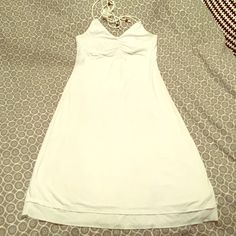 White cotton dress Perfect for summer. White cotton dress halter dress that hits at knee. Tie strings with brown wooden beads at end. Stretchy comfortable material with double hem detail at bottom. Abercrombie & Fitch Dresses Midi