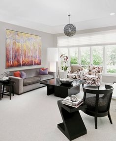 Traditional beige living room decor with taupe sofa and floral chairs
