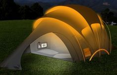 """The Orange tent is a concept idea which aims to be the """"Tent of the Future"""". It was designed by Orange and is covered with fabric solar panels allowing you to make sure your essential gadgets can always be kept charged."""