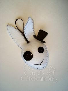 White rabbit felt plushies. Hand sewn with ribbon hanging loops, button eyes, lace bows and stiffened felt hats