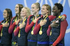United States goalkeeper Ashleigh Johnson, right, and the rest of the USA…