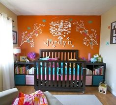 Similar set up, love bookcases on either side of crib, name on wall above