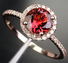 want!! rose gold with garnet