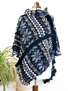 This luxuriously soft, fairisle patterned poncho was made from a mohair and acrylic mix sweater and features lovely, large patterns in black, white