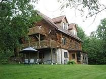 SOLD! Round Log Home on 118 Acres Includes a huge Garage.