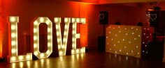 Mighty Fine Entertainment Wedding DJs, providing wedding music, production and light up letters for wedding at Stoke Place Hotel, Buckinghamshire. www.mfent.co.uk