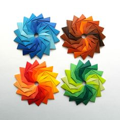 https://flic.kr/p/qSgHRw   rainbow collection   Woven stars, 16 squares 3.5 cm of kami, final size 6.5 cm.  My old model. Diagram: unit, joining units.