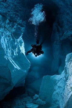 Diver in a cave system - via www.murraymitchell.com