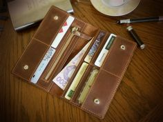 Color: COGNAC ●▬▬▬●● DESCRIPTION ●●▬▬▬● This is all-in-one wallet. It suitable both for women and for men. For crafting this card holder we have used natural leather and reinforced yarn to guarantee durability of the handiwork. ●▬▬▬●●DESIGN●●▬▬▬● Travel w Leather Card Wallet, Handmade Leather Wallet, Leather Gifts, Leather Bag, Passport Wallet, Coin Wallet, Iphone Wallet, Minimalist Leather Wallet, Leather Laptop Backpack