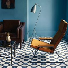 Love this colour blue for the walls: might be an improvemnt on our own living room walls. blues and tans; geometric patterns and lines