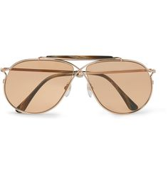 Perfect for the summer, TOM FORD's 'Private Collection' aviator-style sunglasses are crafted from rose gold-tone Japanese titanium for durability and a lightweight feel. A criss-crossed bridge, doubled horn brown bar and brown photochromic lenses round them off with panache.