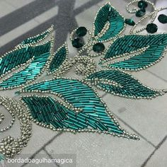 Photo only - beaded leaves in teal & silver Bead Embroidery Patterns, Tambour Embroidery, Hand Work Embroidery, Couture Embroidery, Bead Embroidery Jewelry, Gold Embroidery, Embroidery Fashion, Hand Embroidery Designs, Embroidery Stitches