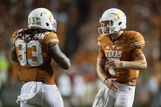 RB D'Onta Foreman and QB Shane Buechele