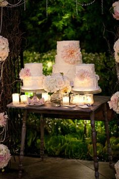 Gorgeous wedding cake trio table - candles  large flowers
